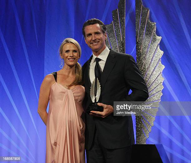 Lieutenant Governor of California Gavin Newsom poses a for a photoo with his wife Jennifer Siebel Newsom after being awarded the Golden Gate Award...
