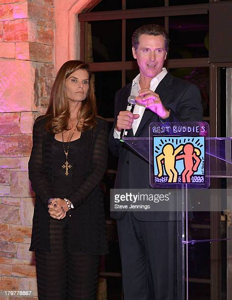 Lieutenant Governor of California Gavin Newsom speaks to the audience as Maria Shriver looks on during Best Buddies Challenge Hearst Castle Kickoff...