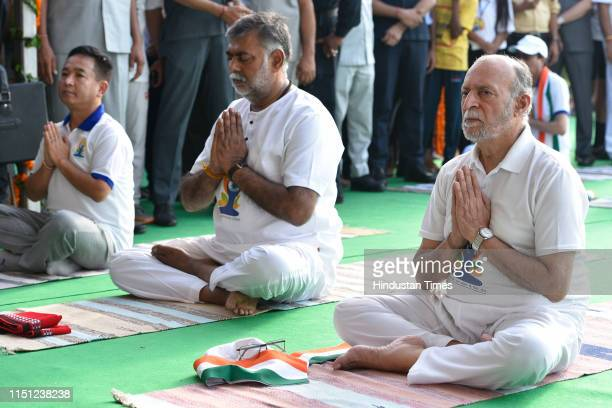 Lieutenant Governor of Delhi Anil Baijal and other political leaders participate in a mass yoga session on International Yoga Day at Rajpath on June...