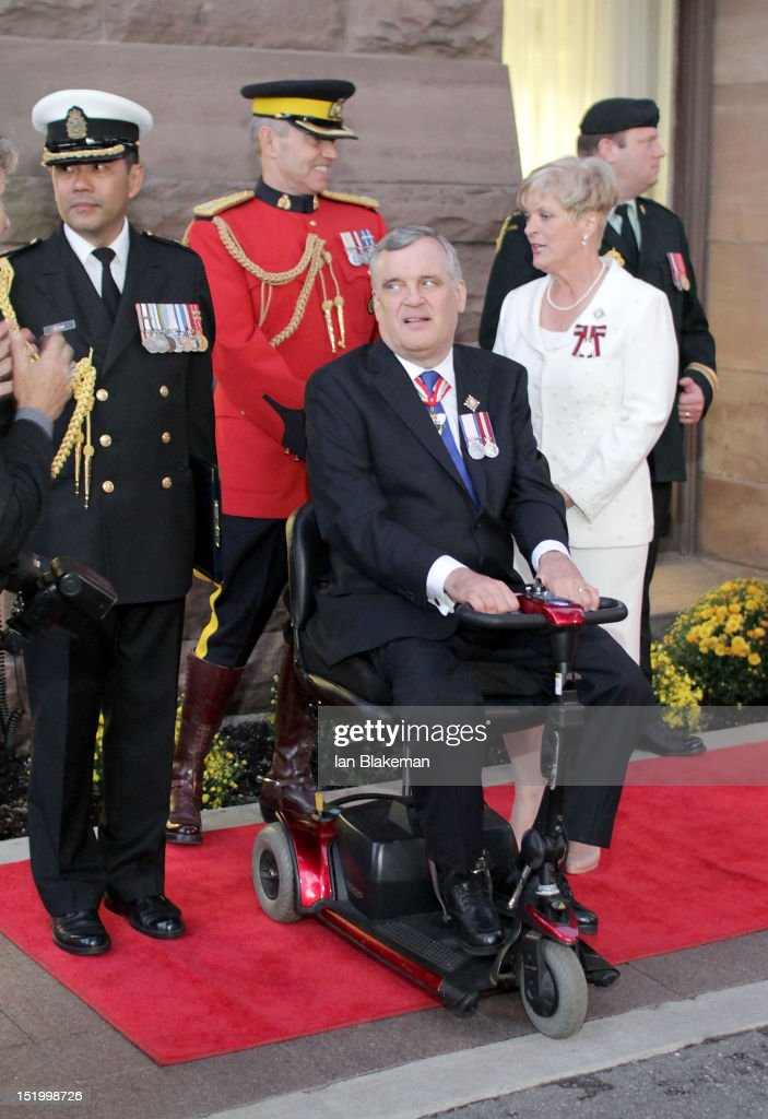 Lieutenant Governor of Ontario David Onley (C) and Ruth Onley attend the presentation of the Queen's Diamond Jubilee Medals during the 2012 Toronto International Film Festival at Queen's Park on September 14, 2012 in Toronto, Canada.