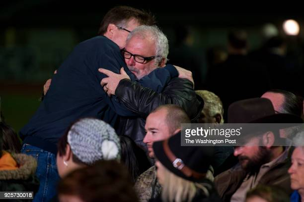 Lieutenant Governor of Texas Dan Patrick hugs Stephen Williford who shot at the shooter chasing him away during a vigil for victims in the Sutherland...