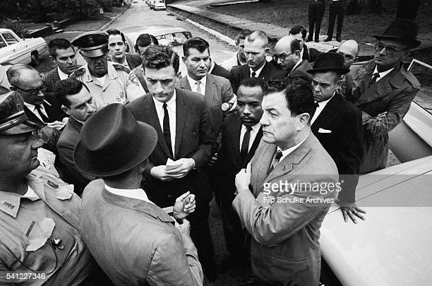 Lieutenant Governor Paul Johnson blocks James Meredith from walking on to the University of Mississippi campus hence integrating the school Meredith...
