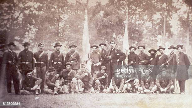 Lieutenant H Glenville and Captain A Vallendar pose with their men of Company H 125th Ohio Infantry Regiment during the American Civil War