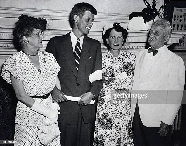Lieutenant John F Kennedy stands with his mother Rose and her parents Mr and Mrs Joseph Fitzgerald after a speech at Faneuil Hall John Fitzgerald...