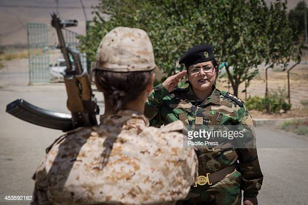 Lieutenant Jwan salutes a woman Peshmerga of the 2nd Battalion during a military exercise The 2nd Battalion is exclusively comprised of 550 female...