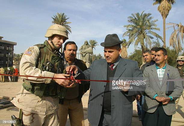 Lieutenant Marc Coats from the 40th Engineer Battalion Commander and Hamid Ralef Mayor of Baghdad's alKarkh area cut a red ribbon to celebrate the...