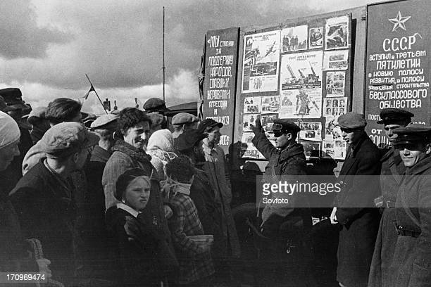 Lieutenant of a soviet tank unit lectures vilno inhabitants about the lives of workers in the ussr, october 1939, vilno, capital of lithuania, was...