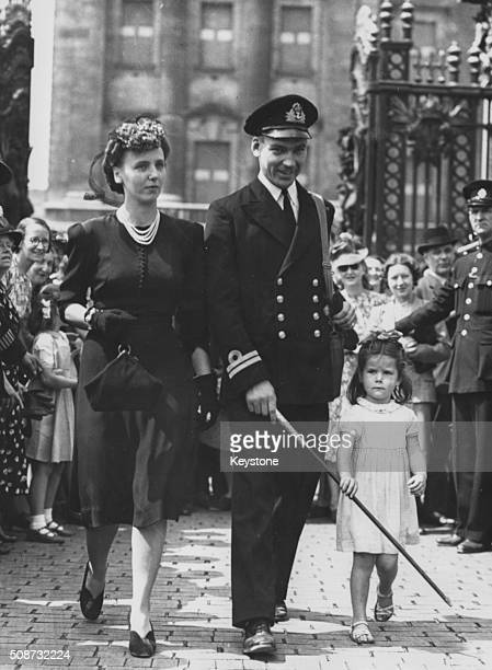 Lieutenant Peter Scawen Watkinson Roberts VC pictured leaving Buckingham Palace with his wife and niece after receiving his Victoria Cross medal...