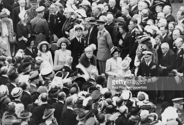 Lieutenant Philip Mountbatten joins the royal family including, from right, King George VI, Queen Elizabeth, Princess Margaret, Queen Mary of Teck,...