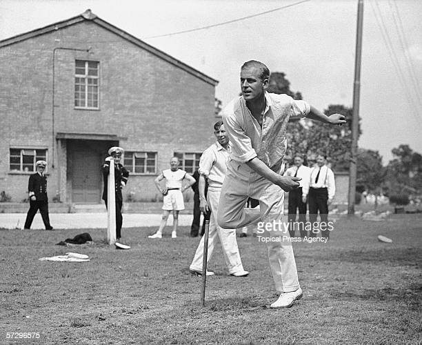 Lieutenant Philip Mountbatten takes a turn at bowling whilst off duty at the Petty Officers' Training Centre in Corsham Wiltshire 1st August 1947