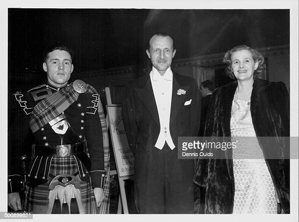 Lieutenant Sir Frederick Browning with his wife, writer Daphne du Maurier, with soldiers of the Scottish pipers , at the Highland Ball, Dorchester...