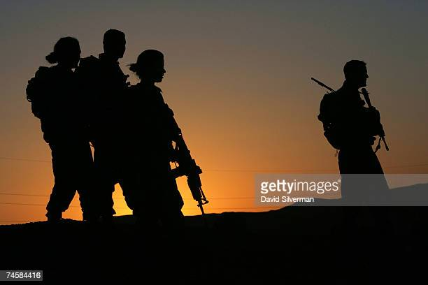 Lieutenant Sivan Ben Ezra a 22yearold deputy company commander in the Israeli army's Caracal battalion and her troops are silhouetted against the...