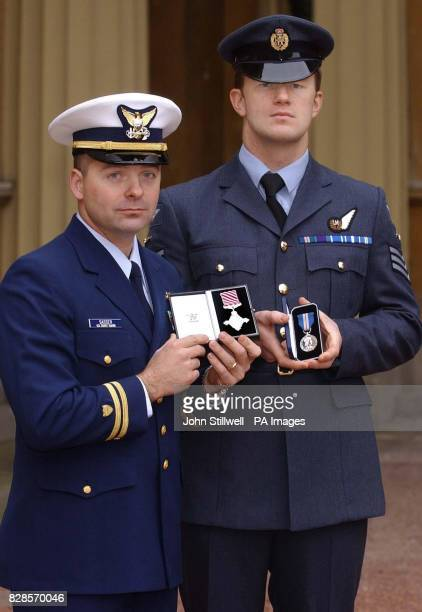 Lieutenant William Sasser of the United States Coast guard holds his Air Force Cross and stands with Sergeant Neil Finch of the RAF who holds his...