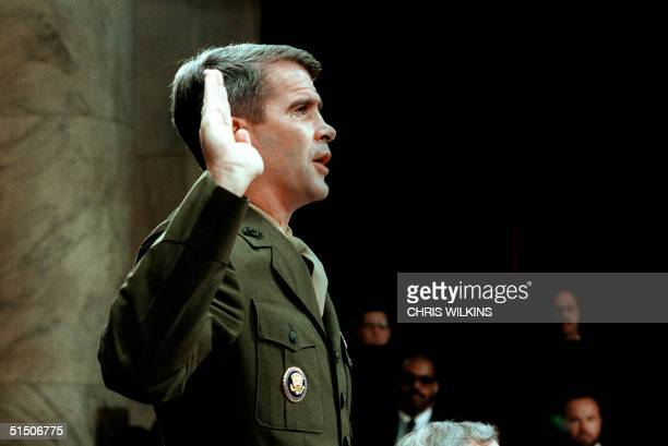 LieutenantColonel Oliver North former aide to former National Security Adviser John Poindexter is sworn in 07 July 1987 before the House and Senate...