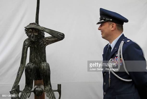 LieutenantColonel Sean Cosden of the US Defence Attache looks at the statue of 'Tojo' at O'Donovan's Hotel in Clonakilty The monkey belonging to an...
