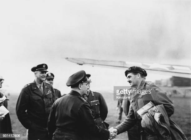 LieutenantGeneral Lewis H Brereton of the US Air Force commander of the First Allied Airborne Army shakes hands with MajorGeneral Roy Urquhart of the...
