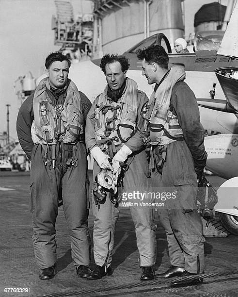 LR Lieutenants D Lang D Price and D Rawbone pilots of Fleet Air Arm 800 Squadron Supermarine Attacker FB2 fighters after landing on the flight deck...