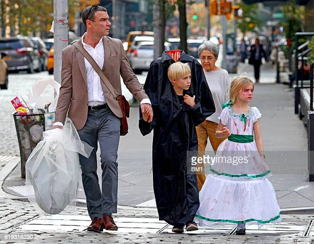 Liev Schreiber and children Samuel and Alexander go trick or treating on October 30 2016 in New York City