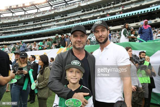 Liev Schreiber and his brother Pablo Schreiber attend the New England Patriots at New York Jets game at MetLife Stadium on October 15 2017 in East...
