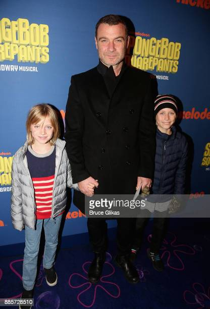 Liev Schreiber and sons pose at the opening night arrivals for the new musical 'Spongebob Squarepants' on Broadway at The Palace Theatre on December...