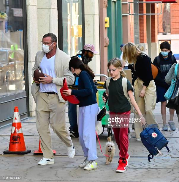 Liev Schreiber and Taylor Neisen and are seen walking in Soho on March 12, 2021 in New York City.