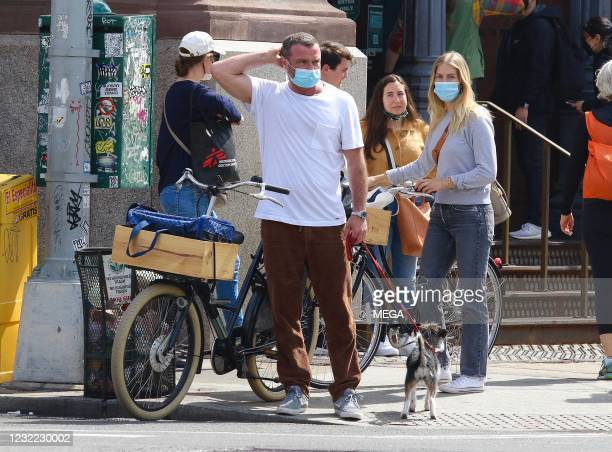 Liev Schreiber and Taylor Neisen are seen on April 10, 2021 in New York City.