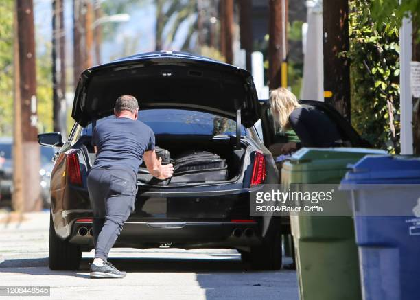 Liev Schreiber and Taylor Neisen are seen on March 27 2020 in Los Angeles California