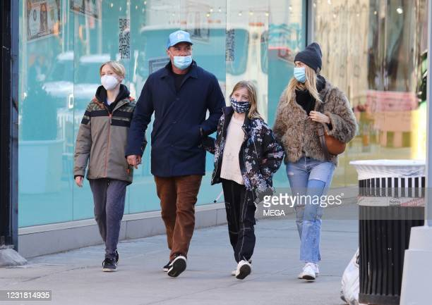 Liev Schreiber and Taylor Neisen out for a walk on March 19, 2021 in New York City, New York.