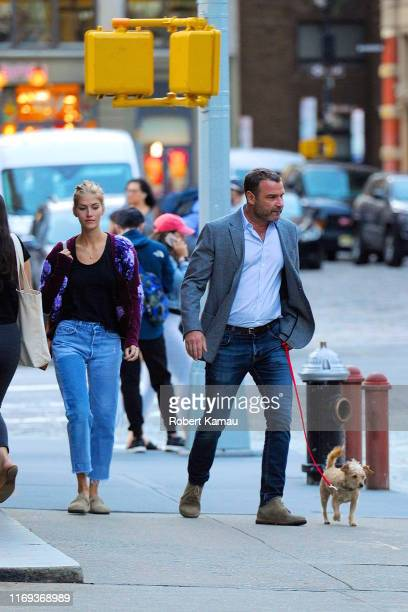 Liev Schreiber and Taylor Neisen seen walking their dog in Manhattan on September 18 2019 in New York City