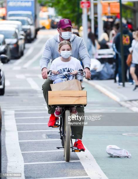 Liev Schreiber is seen biking in soho on May 13, 2021 in New York City.