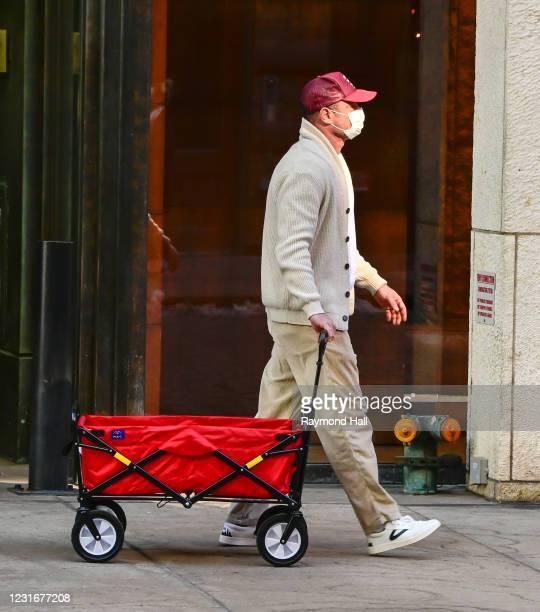 Liev Schreiber is seen walking in Soho on March 12, 2021 in New York City.