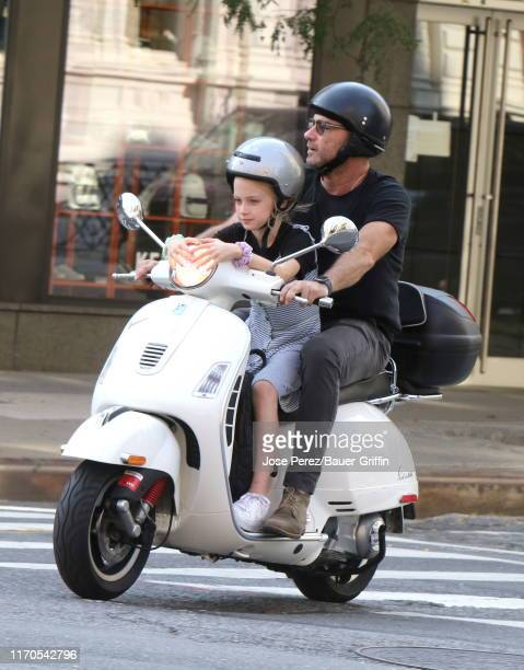 Liev Schreiber is seen with his son Kai riding a scooter on September 23 2019 in New York City