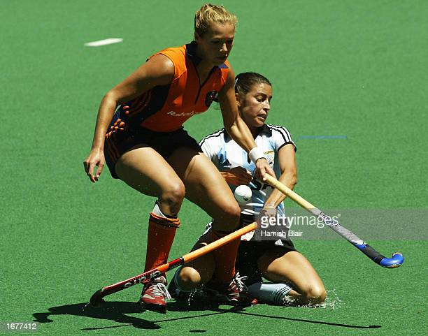 Lieve van Kessel for the Netherlands contests with Mariana Gonzalez Olivia for Argentina during the Women's World Cup Hockey gold medal match between...