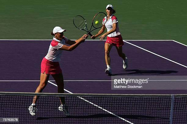 Liezel Huber of Russia hits the ball as she plays with Cara Black of Zimbabwe during the women's doubles final against Lisa Raymond and Samantha...