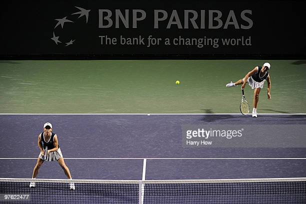 Liezel Huber of the United States and Cara Black of Zimbabwe serve in their match against Shahar Pe'er of Israel and Sara Errani of Italy during the...