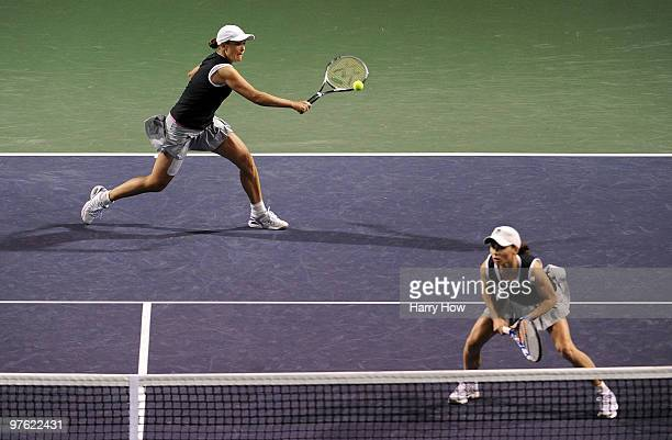 Liezel Huber of the United States and Cara Black of Zimbabwe volley in their match against Shahar Pe'er of Israel and Sara Errani of Italy during the...