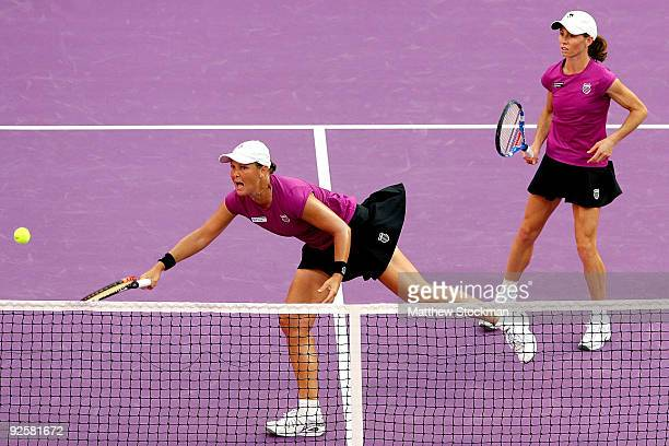 Liezel Huber of the United States lunges for a shot against Samantha Stosur and Rennae Stubbs while playing with Cara Black of Zimbabwe during the...