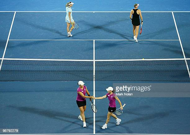 Liezel Huber of the USA and Cara Black celebrate a point in their womens doubles final match against Nadia Petrova of Russia and Tathiana Garbin of...