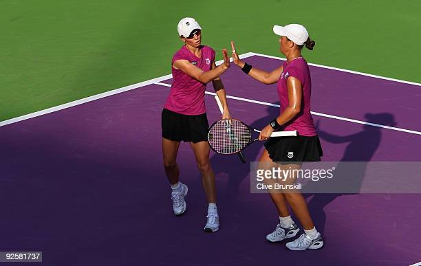 Liezel Huber of the USA and Cara Black of Zimbabwe celebrate a point in the semi-final against Samantha Stosur and Rennae Stubbs of Australia during...
