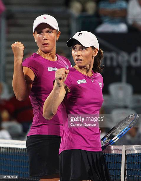 Liezel Huber of the USA and Cara Black of Zimbabwe celebrate match point in their women's doubles final match against Tathiana Garbin of Italy and...