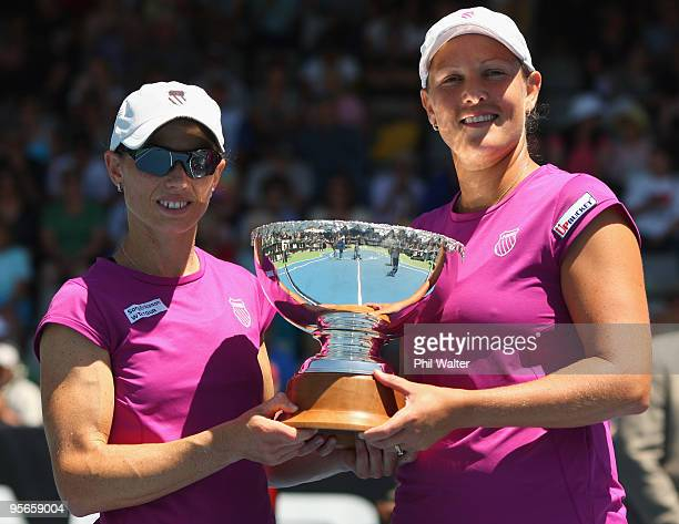 Liezel Huber of the USA and Cara Black of Zimbabwe pose with the trophy following during their doubles final against Natalie Grandin of South Africa...