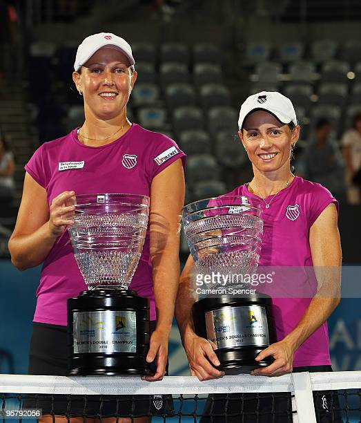 Liezel Huber of the USA and Cara Black of Zimbabwe pose with their trophies after winning the women's doubles final match against Tathiana Garbin of...