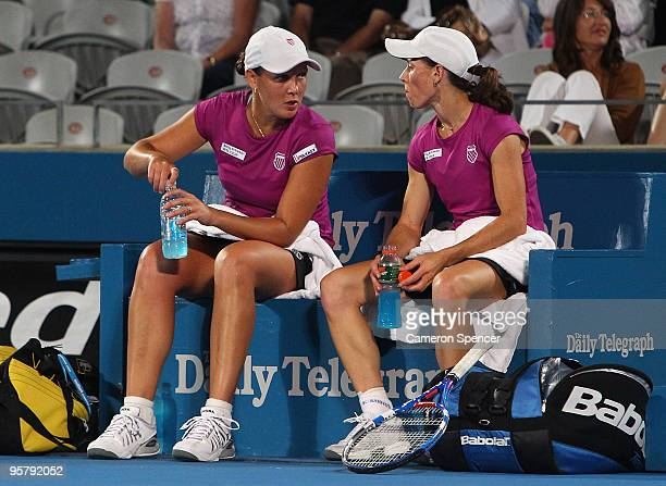 Liezel Huber of the USA and Cara Black of Zimbabwe talk tactics in their women's doubles final match against Tathiana Garbin of Italy and Nadia...