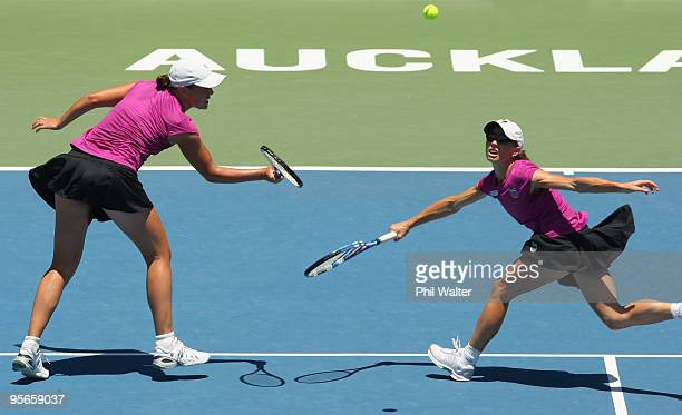 Liezel Huber of the USA and Cara Black of Zimbabwe volley in their doubles final match against Natalie Grandin of South Africa and Laura Granville of...