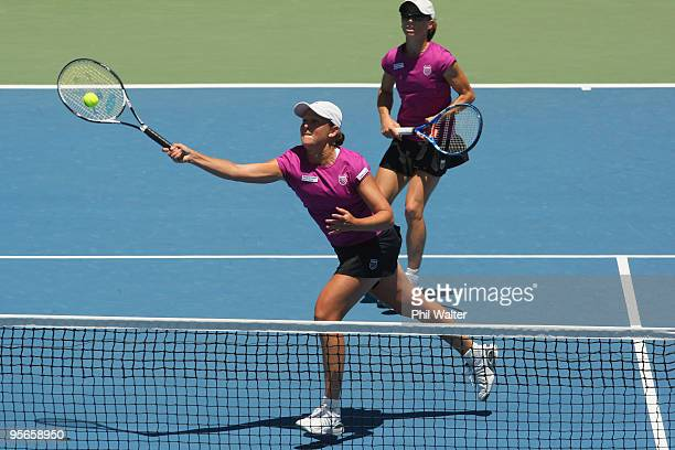 Liezel Huber of the USA volleys at the net with support from Cara Black of Zimbabwe during their doubles final against Natalie Grandin of South...