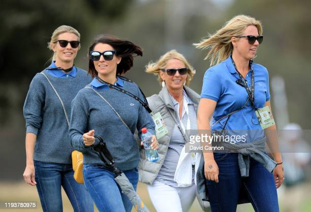 Liezl Els and NelMare Oosthuizen leading a group of International Team wives and supporters on course during the second day foursomes matches in the...
