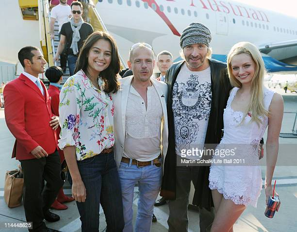 Life Ball organizer Gery Keszler welcomes model Emma Willis entertainer Thomas Gottschalk and model Lydia Hearst who arrive for the Life Ball 2011...