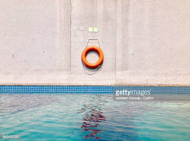 Life Belt Hanging On Wall By Swimming Pool