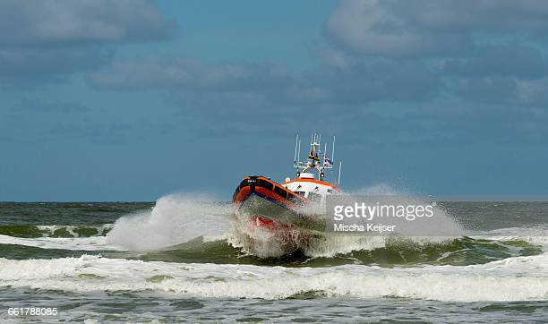 life boat on ocean, west aan zee, friesland, netherlands - lifeboat stock pictures, royalty-free photos & images