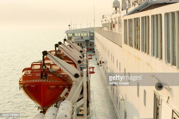 life boats on a north sea ferry from newcastle to amsterdam - lifeboat stock pictures, royalty-free photos & images